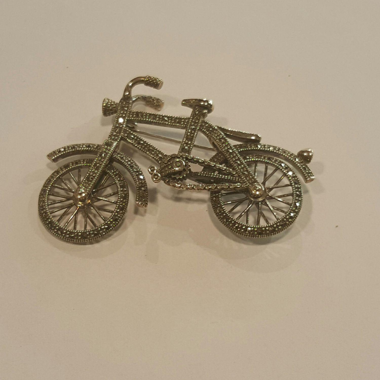Zilveren fiets bezet met markasiet - Goudcentrum.nl