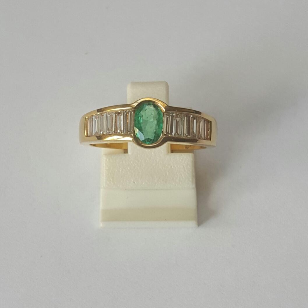 18 krt. gouden ring baguette smaragd - Goudcentrum.nl